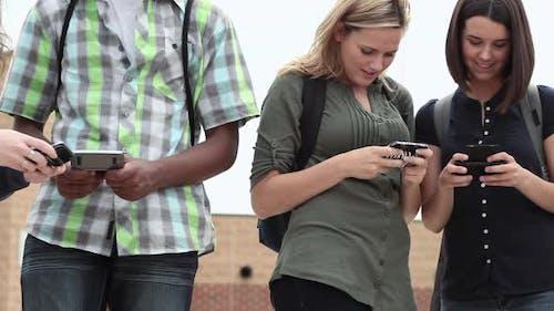 High school students using smartphones
