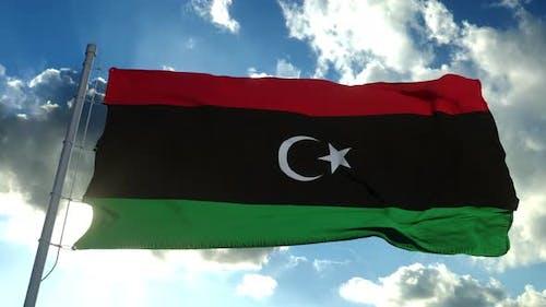 Libya National Flag Waving Wind Blue Sky Background
