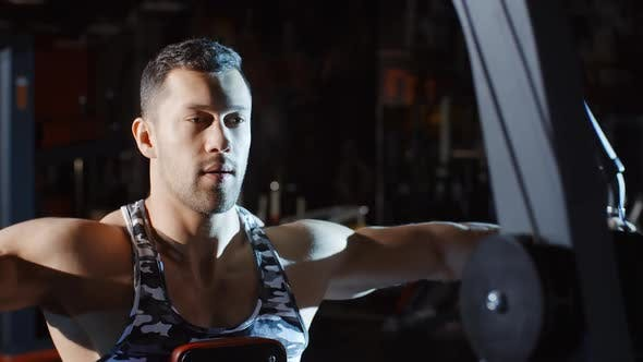 Thumbnail for Muscular Man Athlete Doing Workout and Training Hands and Chest on Weights Exercise Machine