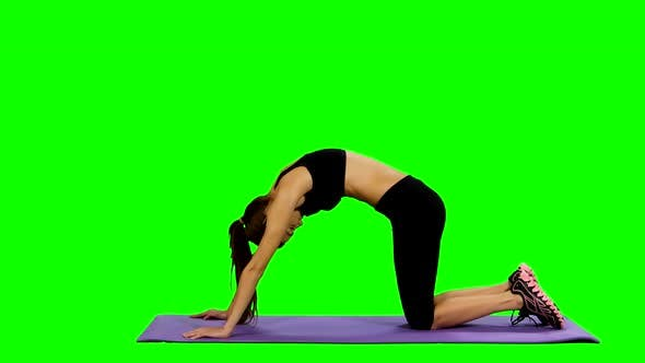 Thumbnail for Young Woman Practicing Yoga in Gym, Green Screen