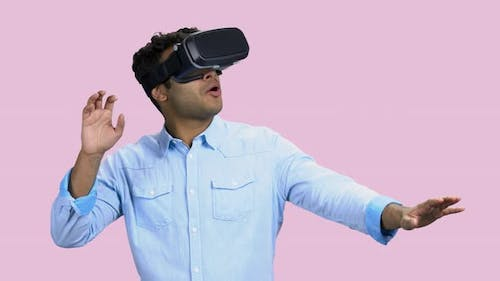 Young Scared Man Wearing Virtual Reality Goggles