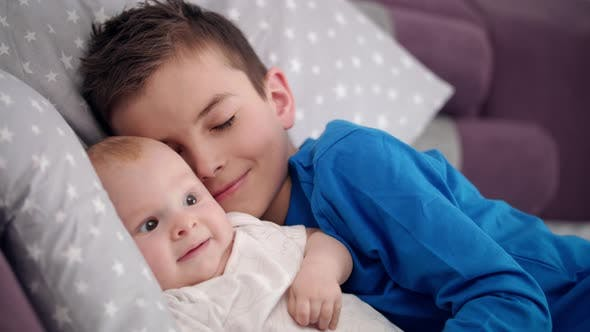 Thumbnail for Siblings Sleeping Together. Boy Touching Adorable Child. Lovely Tenderness
