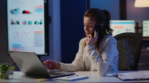 Thumbnail for Woman Employee Speaking at Phone While Working at Laptop