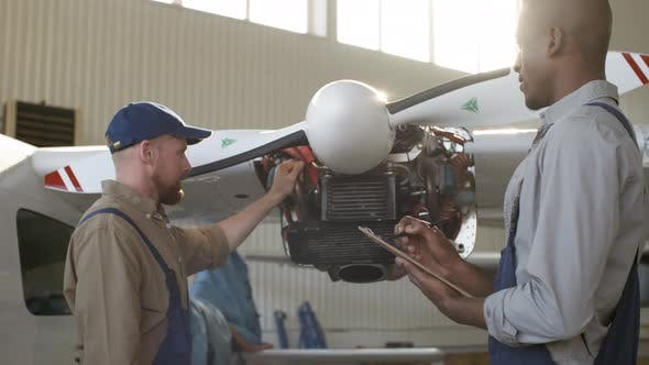 Thumbnail for Multiethnic Aircraft Mechanics Examining Airplane