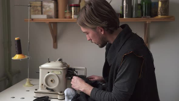 Thumbnail for Young Man Tailor Sewing Fur on Furrier Machine