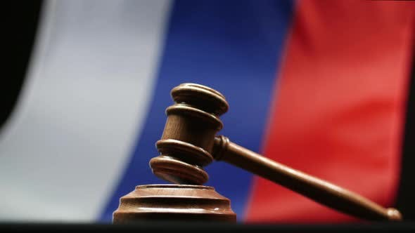 Thumbnail for Judge's Wooden Gavel On Block Against Russian Flag Waving In Russian Federation Court