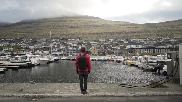 Thumbnail for Man Standing At Harbour Of Remote Town