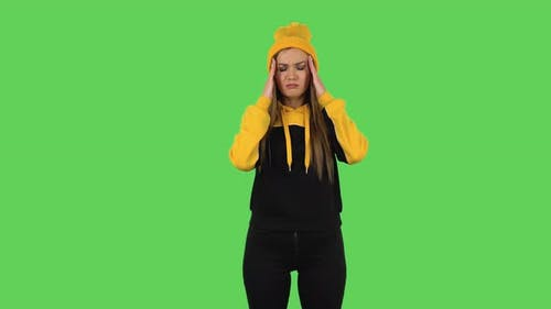 Modern Girl in Yellow Hat Got a Cold, Sore Throat and Head, Cough . Green Screen