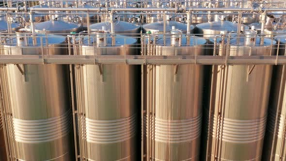 Shiny silos in a chemical factory - stainless steel containers in chemical industry plant