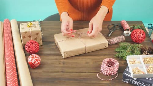 Christmas unready hand crafted gift box on rustic wooden table