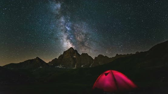 Thumbnail for Time Lapse Milky Way Galaxy Stars Over Snowcapped Mountain Peak, Camping Tent Night Sky Stargazing
