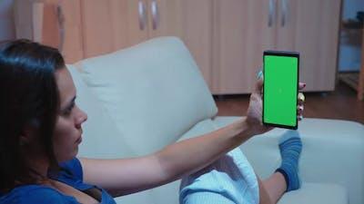 Lady Reading on Smartphone Mockup