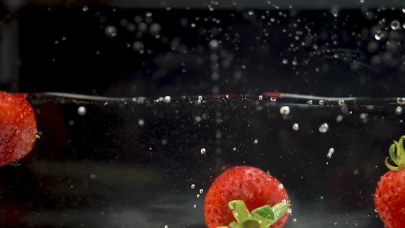 Thumbnail for Strawberry hitting another one when falling in the water