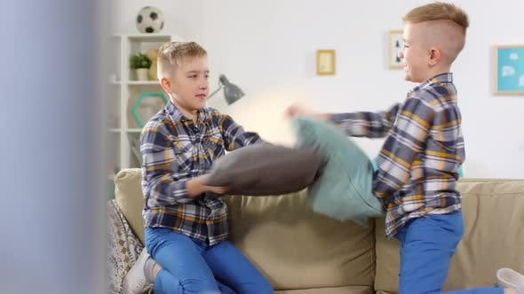 Thumbnail for 10-Year-Old Twins Having Vigorous Pillow Fight
