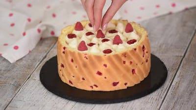 Chef Decorating Mousse Cake with Berry