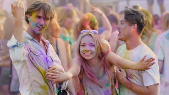 Thumbnail for Funny Male and Female Covered in Paint Having Fun and Waving Hands at Holi Fest
