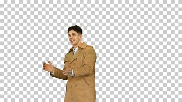 Thumbnail for Young man wearing trench coat dancing and having fun, Alpha Channel