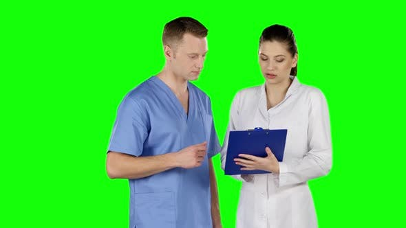 Thumbnail for Two Doctors Explaining About Patient. Green Screen