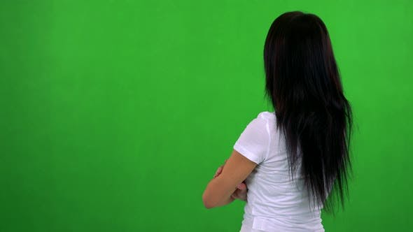 Thumbnail for Young Pretty Woman Looks Around - Shot on Back (Woman Looks To Screen) - Green Screen - Studio