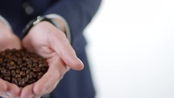 Thumbnail for Unrecognizable Man Holding Handful of Coffee Beans