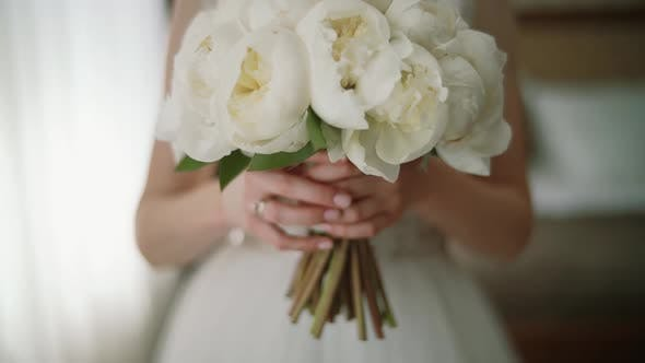 Thumbnail for The Morning of the Bride in a White Roses Holds in Her Hands a Wedding Bouquet of Roses. Close Up