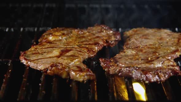 Beef Steaks On Hot Barbecue Grill 06
