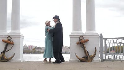 Senior man and woman dancing together in the park. The concept of a healthy lifestyle.