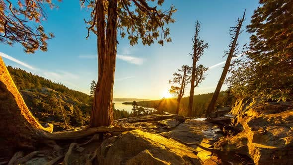Thumbnail for Tilting shot of the sunrise over Emerald Bay in Nevada with lens flare