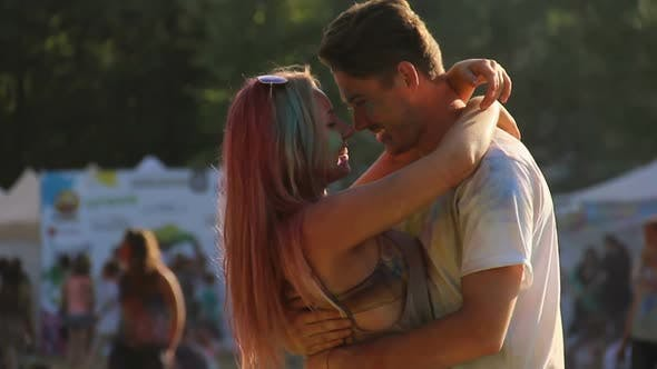 Thumbnail for Happy Couple Colored With Powder Paint Dancing and Hugging at Holi Festival