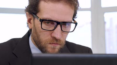 Businessman Looking at Laptop Screen