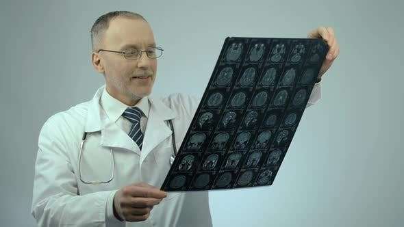 Thumbnail for Happy Smiling Doctor Checking MRI Brain Scan Satisfied With Treatment Results
