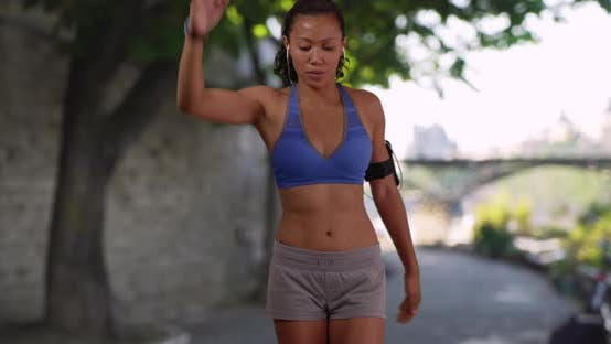 Thumbnail for Mixed-race millennial woman warming up for jog along the Seine