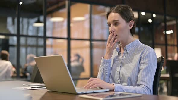 Young Woman Shocked By Loss on Laptop
