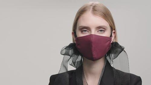 Portrait of Female Model in Stylish Face Mask