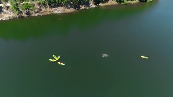 Thumbnail for Group of Paddlers Are Canoeing Along the Lake