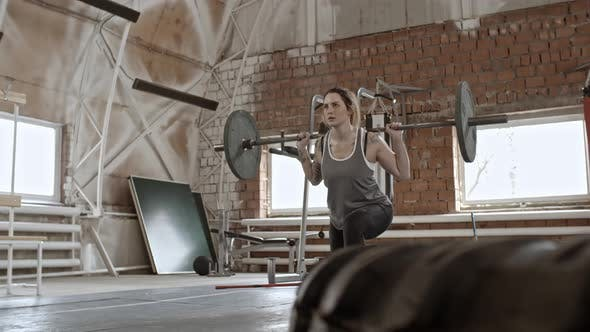 Thumbnail for Muscular Woman Doing Barbell Lunges and Squats