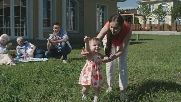 Little Toddler Girl Learning to Walk
