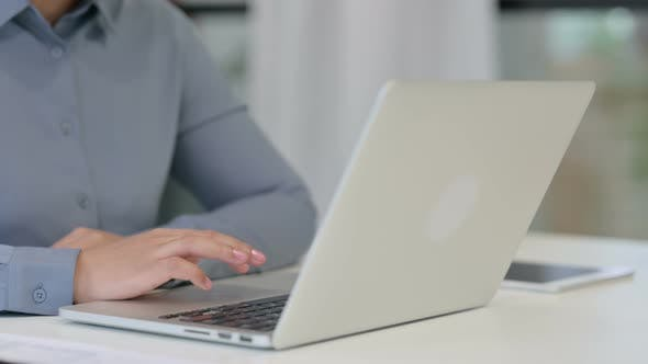 Close Up of African Woman Working on Laptop