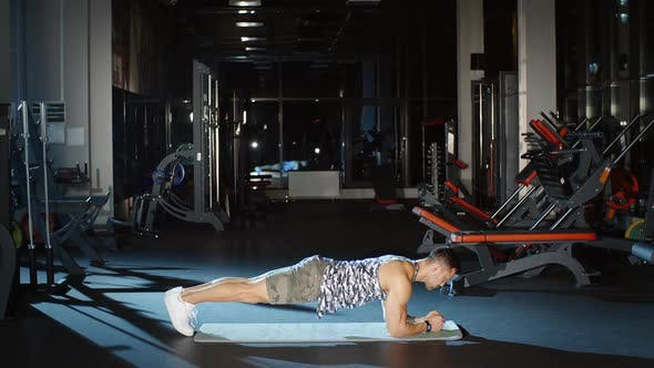 Thumbnail for Sportsman Doing Plank Pose Cardio Workouts on Floor Fitness Mat in Gym