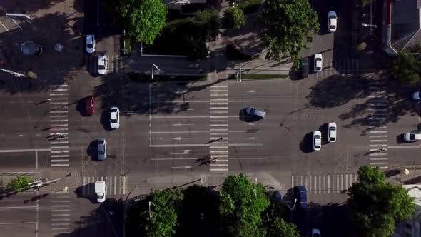 Thumbnail for Drone's Eye View - Aerial View of Busy Crosswalk Intersection