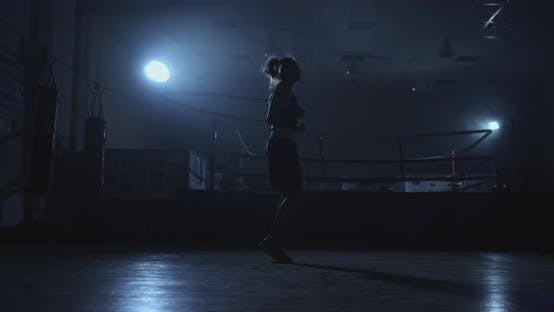 Thumbnail for Beautiful Woman Boxer Jumping in the Boxing Gym Near the Ring on the Jumpers