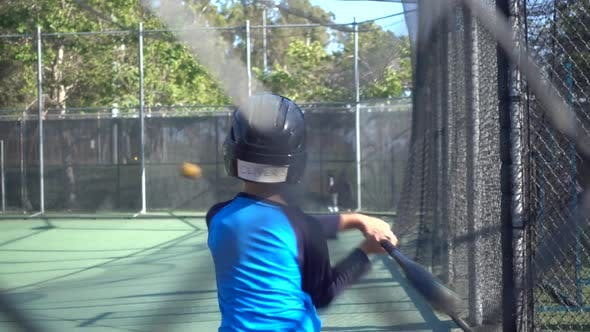 Thumbnail for A boy practices baseball at a batting cage.