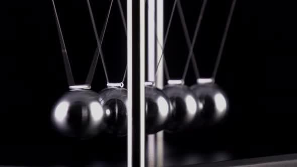 Thumbnail for Newton's Cradle Slow Motion