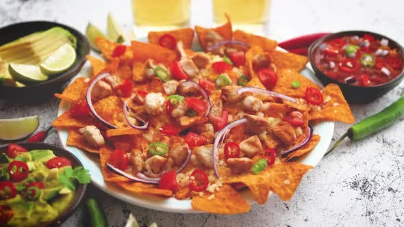 Thumbnail for Mexican Corn Nacho Spicy Chips Served with Melted Cheese