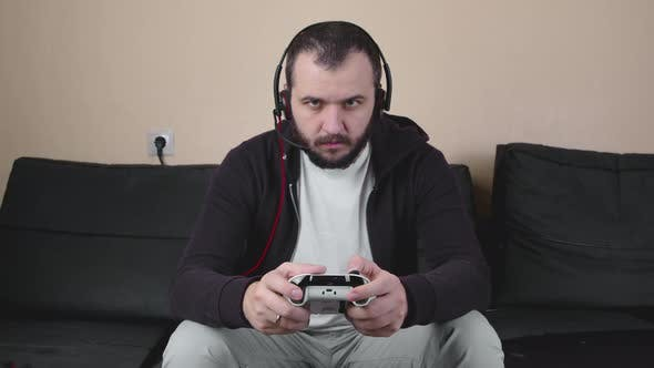 Concentrated Handsome Man Gamer Play Online Strategy Video Game, Loses