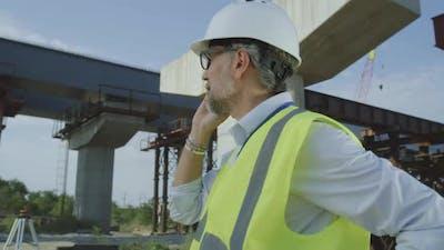 Mature Contractor Speaking on Smartphone