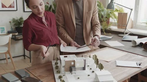 Professional Architects Discussing House Design