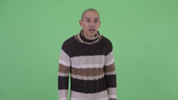 Cover Image for Happy Bald Multi Ethnic Man Getting Good News Ready for Winter
