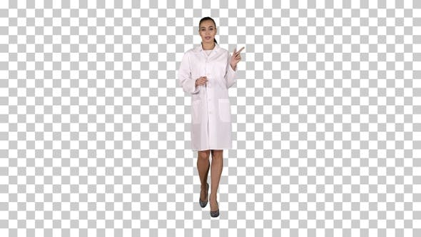 Thumbnail for Attractive doctor pointing to the side presenting product