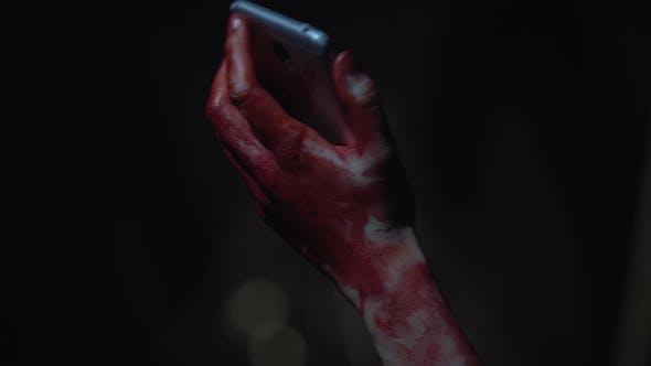 Thumbnail for Maniac Victim Holding Smartphone in Bloody Hands, Calling Police to the Rescue
